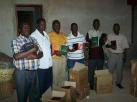 Receiving Bibles to distribute in their Regions of ministry